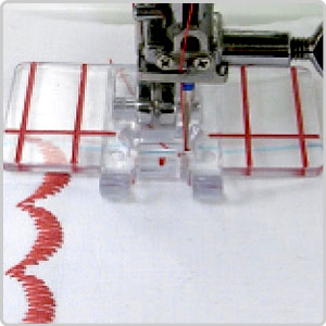 The Janome Border Guide Foot in use