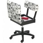Horn Gas Lift Sewing Chair Black and White Opened showing the storage area ()