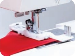 janome-dm7200-features-a-automatic-buttonhole-foot-with-plate-min
